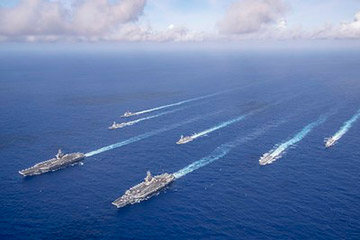 The Theodore Roosevelt and Nimitz Carrier Strike Groups transit the Philippine Sea in formation while conducting dual carrier and airwing operations, June 23, 2020.