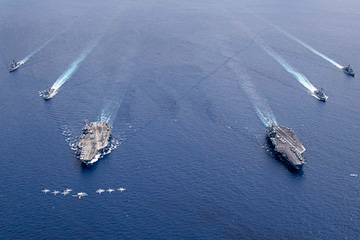 Aircraft from Carrier Air Wings (CVW) 5 and 17 fly in formation over the Nimitz Carrier Strike Force.