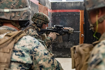 Sgt. Christopher Dullea, assigned to Fleet Anti-Terrorism Security Team Company, Europe (FASTEUR), part of Navy Expeditionary Combat Force Europe-Africa/Task Force (CTF) 68, demonstrates proper room clearing procedures during interior tactics training at Naval Station Rota, Spain, July 9, 2020.