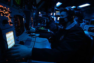 Operations Specialist 2nd Class Jag McManamy, from Ft. Myers Fla. operates a radar systems controller during air defense exercises in the combat information center of the Ticonderoga-class guided-missile cruiser USS Shiloh (CG 67) during Keen Sword 21.