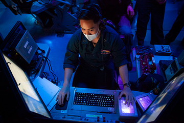 Lt. Jeffrey Alcantara, from Los Angeles, Calif., the anti-terrorism officer assigned to the Arleigh Burke-class guided-missile destroyer USS Barry (DDG 52), stands ballistic missile defense (BMD) officer watch in the ship's combat information center during bi-lateral exercise Resilient Shield 2021.