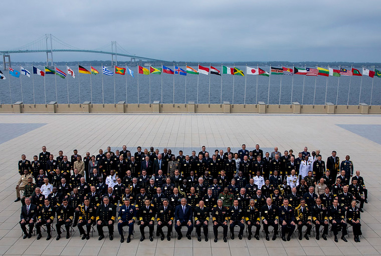 International delegates, including the U.S Secretary of the Navy and heads of navies and coast guards pose for a photo during the 24th International Seapower Symposium.