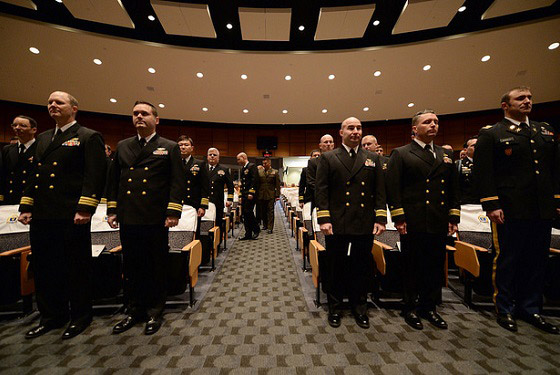 U.S. Naval War College students enter Spruance Auditorium during a graduation ceremony in Newport, Rhode Island.