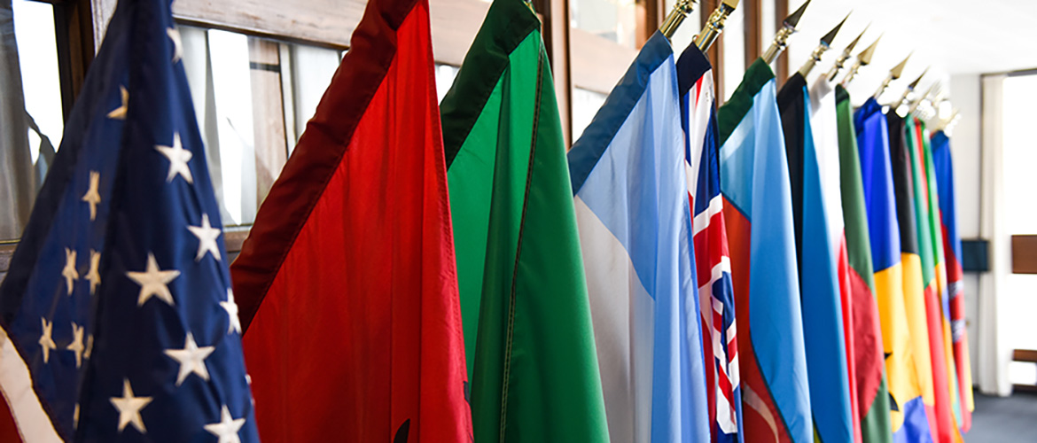 International flags hanging on a wall