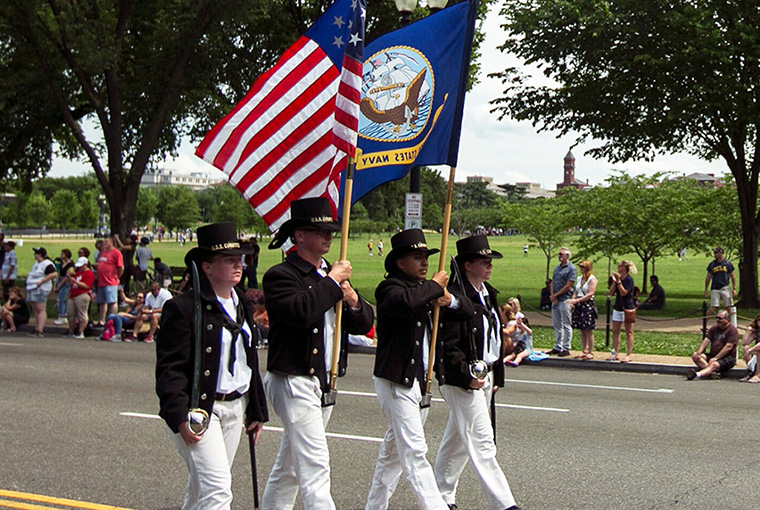 Sailors from USS Constitution march as color guard during the National Memorial Day Parade in Washington D.C.