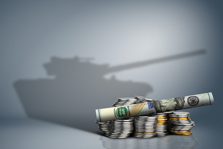 Money arranged so the shadow looks like a military tank.