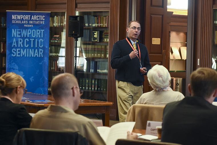 James Holmes, professor, U.S. Naval War College's Strategy and Policy Department, speaks on the principles of seapower during the Newport Arctic Scholars Initiative held at NWC's Mahan Reading Room.