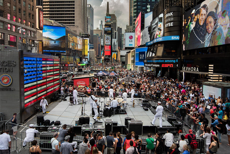 Navy Band Northeast's rock band, Rhode Island Sound, entertains thousands of spectators during one of three concerts held in Times Square in support of Fleet Week New York.