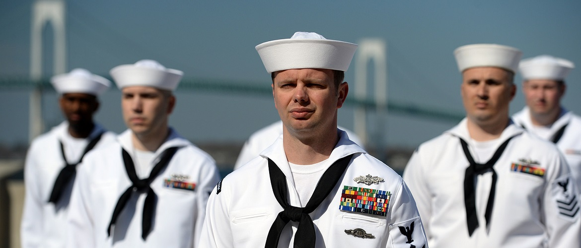 Builder 1st Class Matthew Johnson, assigned to U.S. Naval War College (NWC), stands in formation during a service dress white uniform inspection of enlisted personnel at NWC in Newport, Rhode Island.