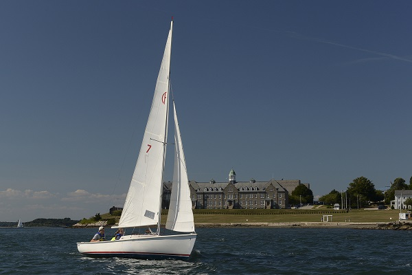 A Rhodes 19 sailboat from Naval Station Newport's Morale, Welfare and Recreation sails past U.S. Naval War College as it transits Narragansett Bay.