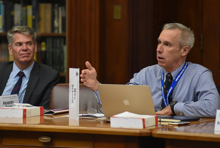 Photo of professor Michael Schmitt discussing the Second Geneva Convention during a legal conference held at the U.S. Naval War College