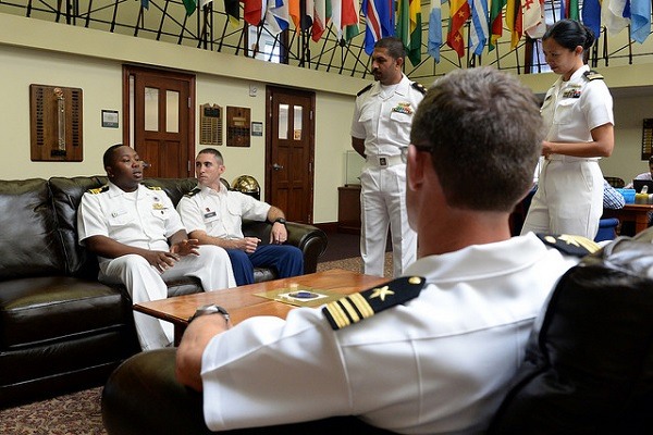 Nigerian navy Lt. Cmdr. Andy Zidon, Army Maj. Geoff Shorr, Kuwaiti navy Cmdr. Mohammad Alarefi, Lt. Cmdr. Katharine Cerezo and Lt. Cmdr. Ted Huebner engage in conversation while attending U.S. Naval War College in Newport, Rhode Island as Naval Staff College students.