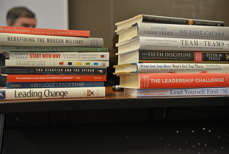 Leadership books sit on a table in the classroom of Gene Andersen, associate professor, College of Leadership and Ethics, U.S. Naval War College.
