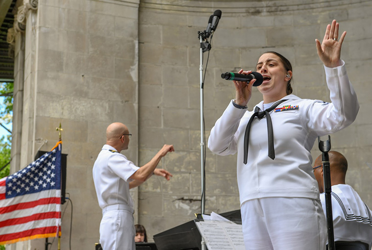 Musician 2nd Class Rachel Vennel sings with Navy Band Northeast's Pops Ensemble during a performance in Central Park in support of Fleet Week New York, 2019.