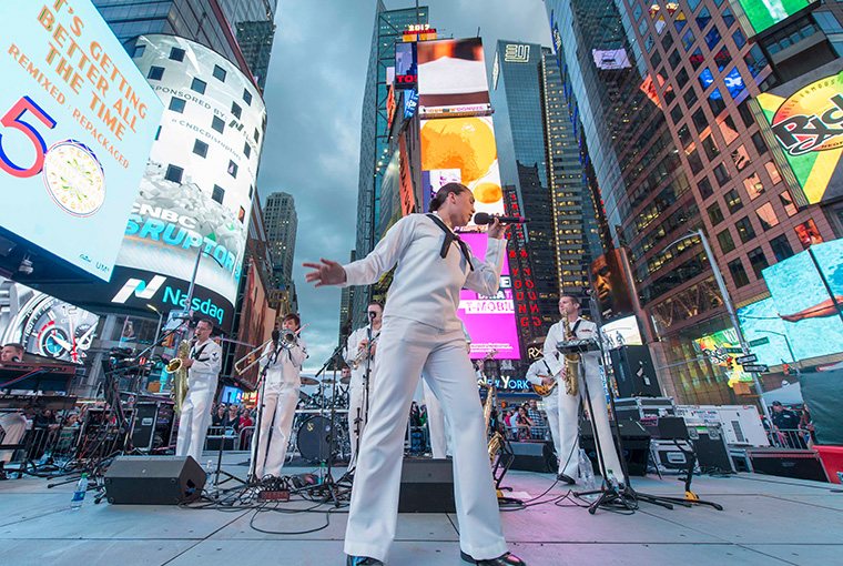 Musician Third Class Cristiana Villalva sings with Navy Band Northeast's Rock Band, Rhode Island Sound in Times Square during Fleet Week New York, 2017.
