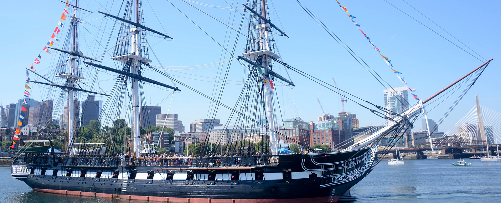USS Constitution is tugged through Boston Harbor to Fort Independence on Castle Island during 'Old Ironsides' underway commemorating Independence Day.