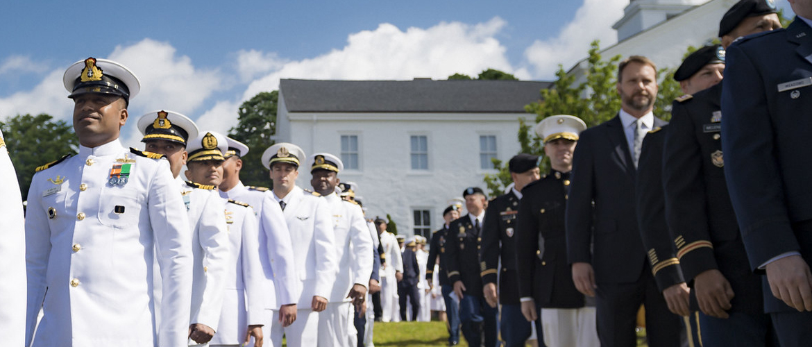Students of U.S. Naval War College's (NWC) 2019 graduating class participate in a commencement ceremony on Dewey Field in Newport, R.I., June 14.