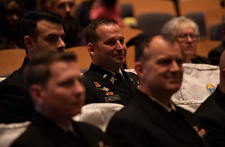 U.S. Naval War College (NWC) graduates participate in a graduation ceremony in NWC's Spruance Auditorium, Nov. 13.