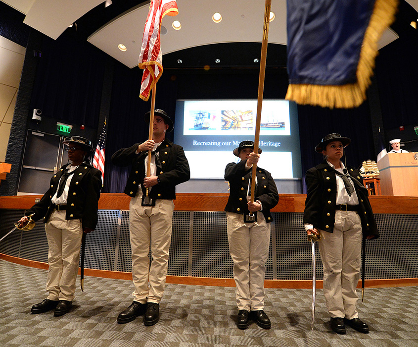 "A color guard from USS Constitution in Boston, Mass., parades the colors during an evening lecture, ""Recreating Our Maritime Heritage,"" at U.S. Naval War College in Newport, Rhode Island."