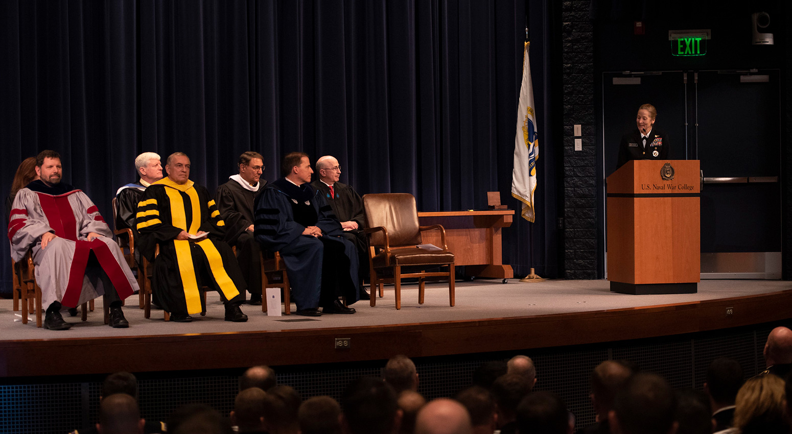 Rear Adm. Shoshana S. Chatfield, president, U.S. Naval War College (NWC), speaks to graduating students during a graduation ceremony in Spruance Auditorium, Nov. 13.