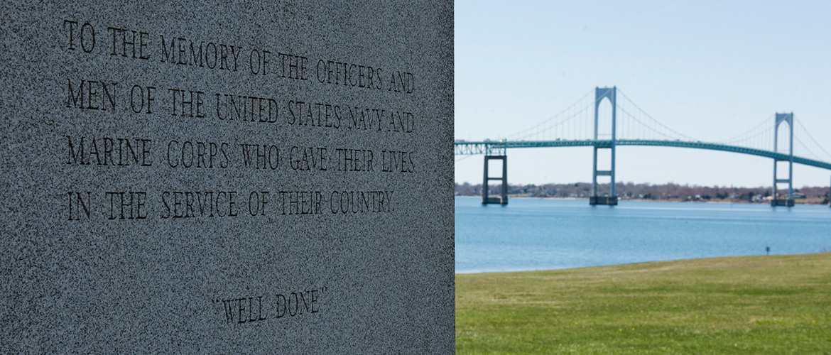 A memory stone with the Newport Pell Bridge in the background.