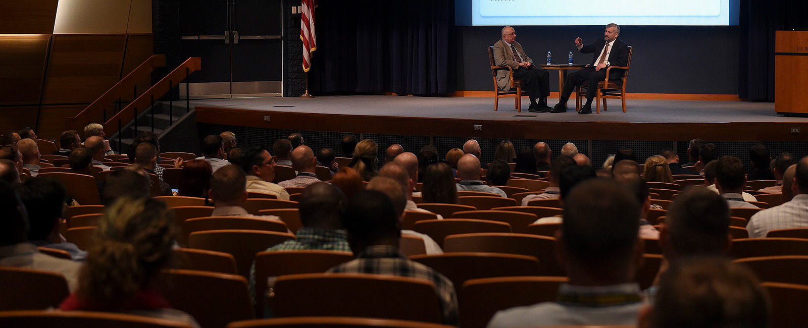 Martin Cook (left), U.S. Naval War College's (NWC) James Bond Stockdale Chair of Professional Military Ethics talks with Karl Marlantes (right), a Marine Corps veteran about Marlantes' experiences and observations about the Vietnam War to NWC students, staff and faculty.
