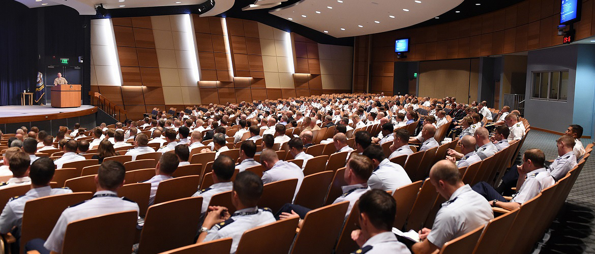 More than 300 new Navy, Army, Air Force, Coast Guard and Marine Corps students listen to an orientation briefing at U.S. Naval War College at Naval Station Newport, Rhode Island.