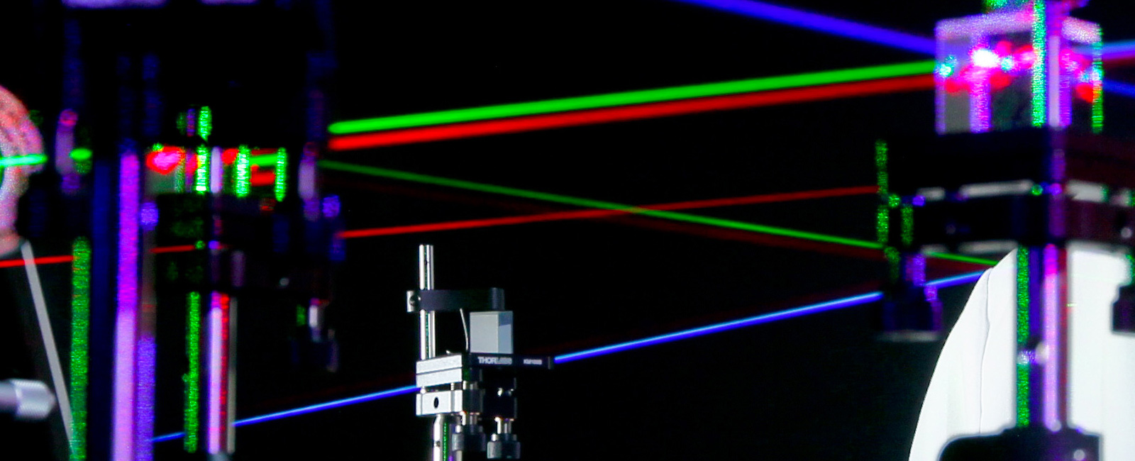 Daniel King, a microwave/electro-optic (MS32) electronics engineer at Naval Surface Warfare Center (NSWC), Corona Division, uses visible lasers to align various optical components.