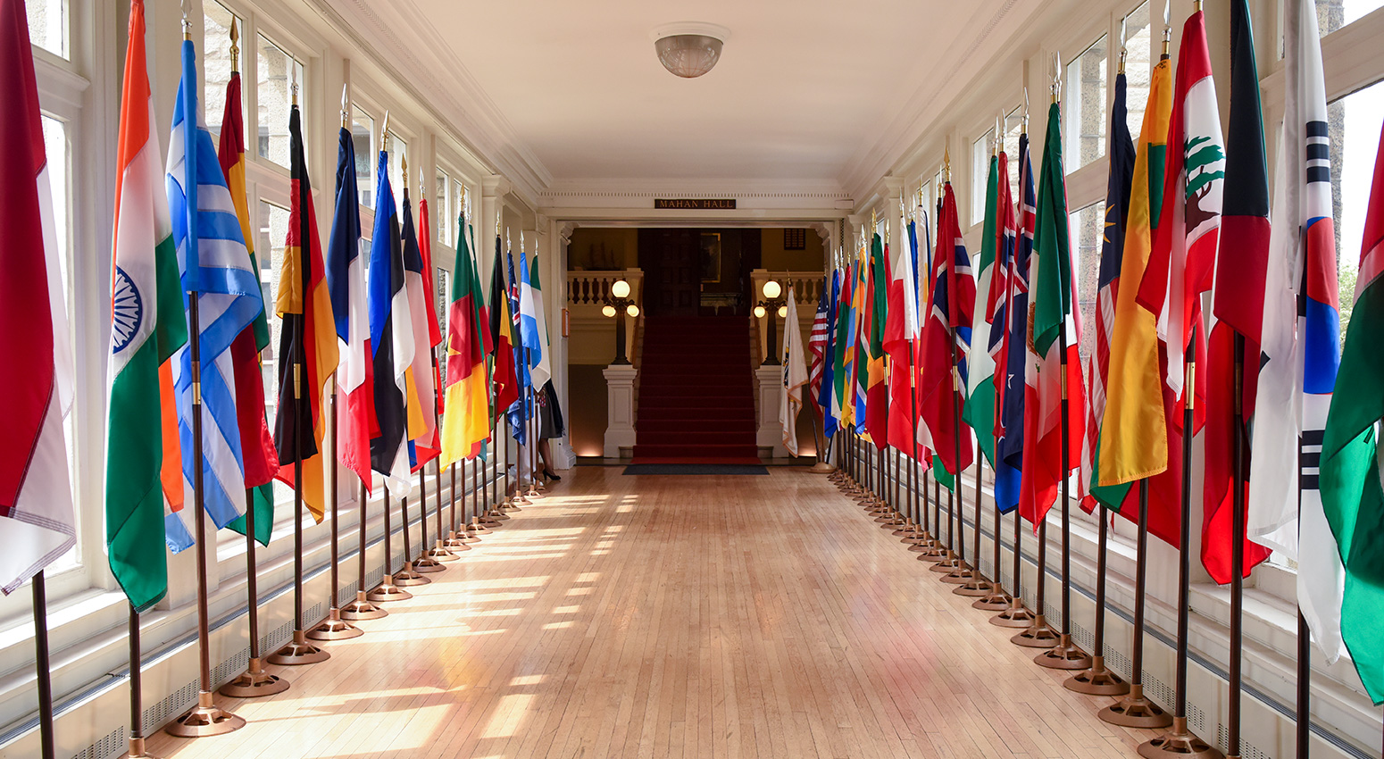 Different international flags down hallway at U.S. Naval War College