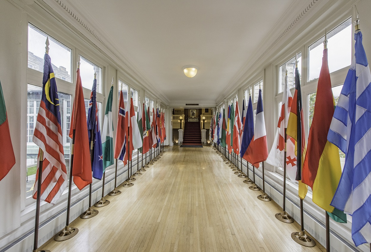 Different international flags down hallway at Naval War College