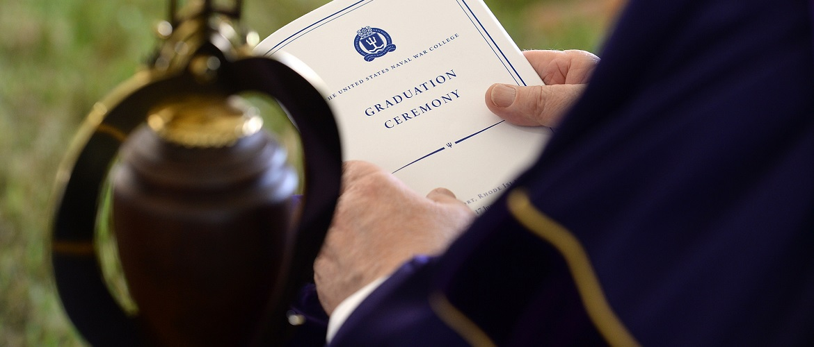 A U.S. Naval War College (NWC) faculty member participates in a graduation ceremony at NWC in Newport, Rhode Island.
