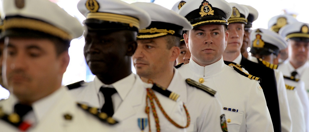 Royal Canadian navy Lt. Cmdr. Samuel Patchell, walks with a procession of international U.S. Naval War College (NWC) students to Dewey Field at NWC in Newport, Rhode Island, in preparation of a graduation ceremony.