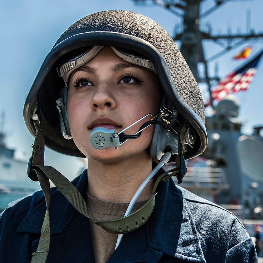 Boatswain's Mate Seaman Alyssa Mullinax stands watch as a phone talker aboard the Arleigh Burke-class guided-missile destroyer USS Porter (DDG 78) while arriving at Naval Station Rota, Spain, April 14, 2019.