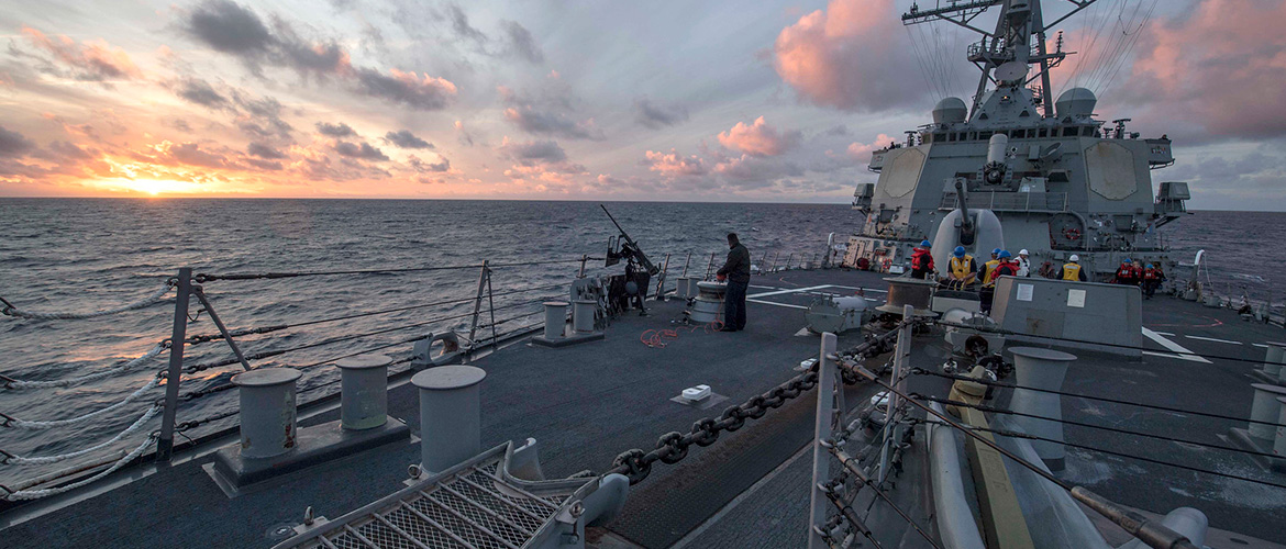 Sailors assigned to the Arleigh Burke-class guided-missile destroyer USS Carney (DDG 64) secure gear following a replenishment-at-sea with the Henry J. Kaiser-class fleet replenishment oiler USNS Kanawha (T-AO 196), Nov. 17, 2019.