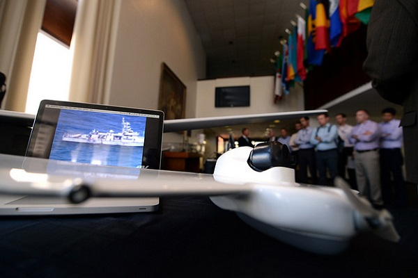 Students assigned to U.S. Naval War College (NWC) view static displays of unmanned aerial vehicles (UAV) in Spruance Hall as part of NWC's Unmanned Systems and Conflict in the 21st Century elective course.