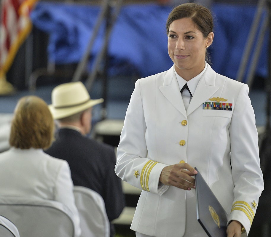 Lt. Lindsay Conte, a U.S. Naval War College (NWC) student, returns to her seat after receiving her Masters of Arts Degree in Defense and Strategic Studies during a commencement ceremony at NWC in Newport, Rhode Island.