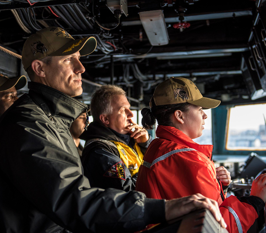 Cmdr. Craig Trent, left, commanding officer of the Arleigh Burke-class guided-missile destroyer USS Porter (DDG 78), observes from the bridge as the ship departs Plymouth, England, Feb. 11, 2019.