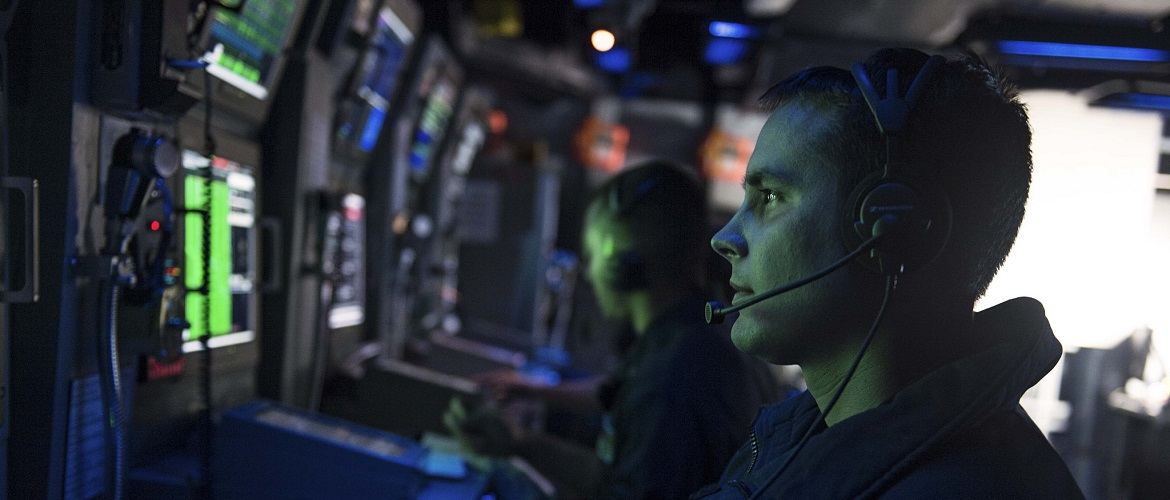 Sonar Technician (Surface) 3rd Class Michael E. Dysthe stands watch in the combat information center during a anti-submarine warfare exercise aboard the Ticonderoga-class guided-missile cruiser USS Chancellorsville (CG 62).