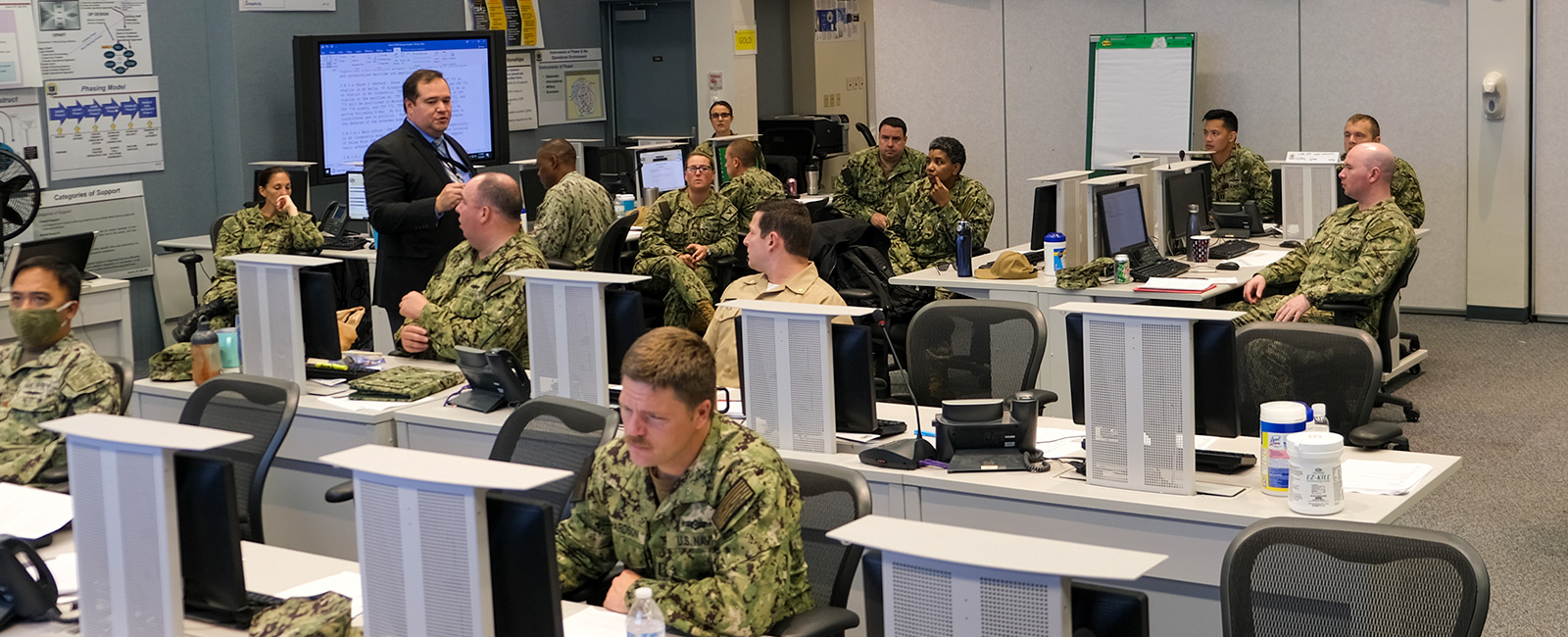 Students in the Maritime Staff Operators Course at the U.S. Naval War College listen to a lecture.