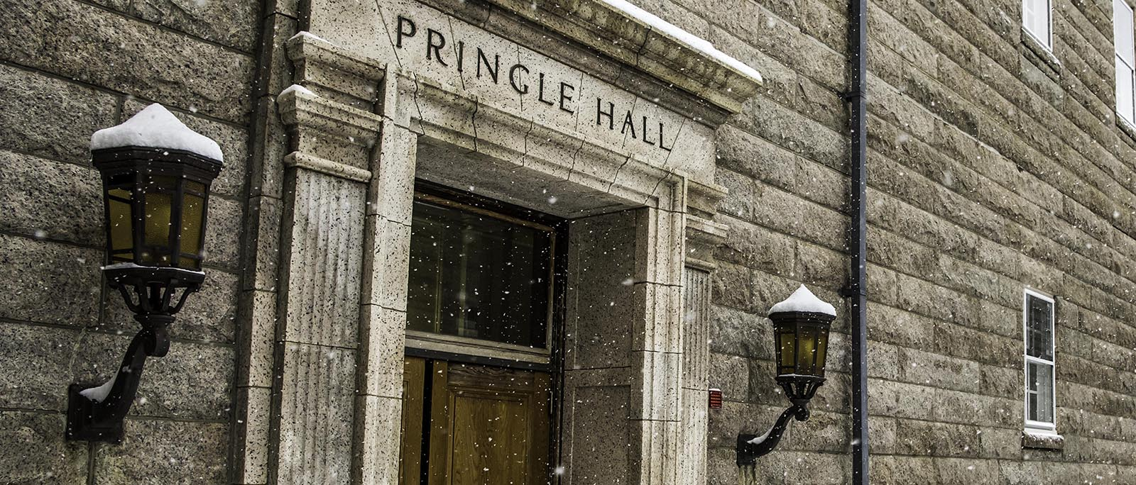 Pringle Hall side view with snow falling at U.S. Naval War College