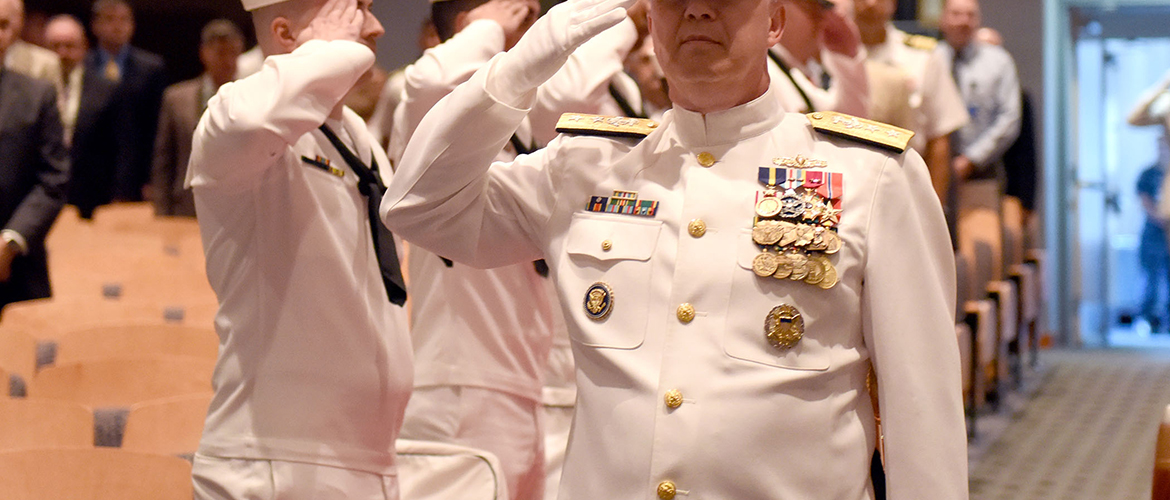 Rear Adm. Jeffrey A. Harley arrives at a change of command ceremony at U.S. Naval War College in Newport, Rhode Island.