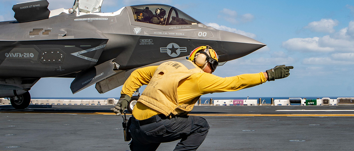 Aviation Boatswain's Mate (Handling) 1st Class Danrey White launches an F-35B Lightning II.